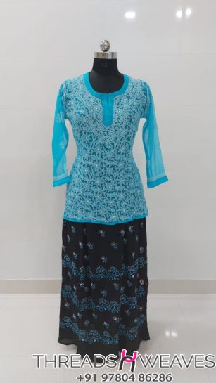 Sky blue and blackCotton crepe and georgette chikankari skirts with Hand chikan embroidery paired with georgette chikankari full embroidered  tops.