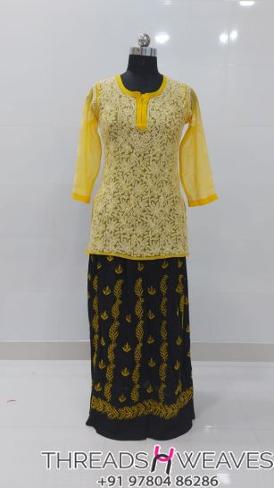 Yellow and blackCotton crepe and georgette chikankari skirts with Hand chikan embroidery paired with georgette chikankari full embroidered  tops.