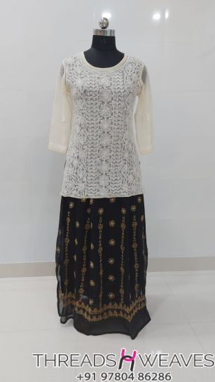 Off white and blackCotton crepe and georgette chikankari skirts with Hand chikan embroidery paired with georgette chikankari full embroidered  tops.