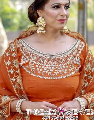 Upadda silk with chinoon embroidery on neck and ghera
