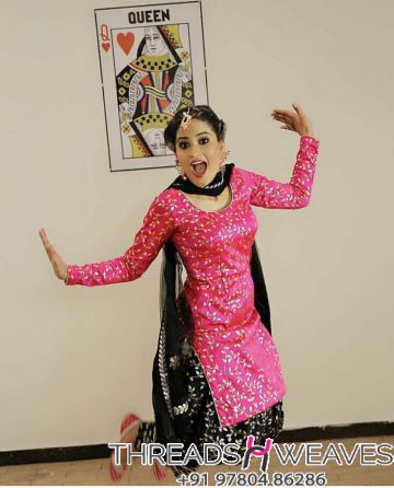 black and pink silk suit
