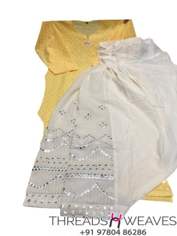 Yellow and White Chikankari kurti with mirror and zari work salwar