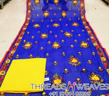 Handcrafted dupatta teamed with cotton dress material